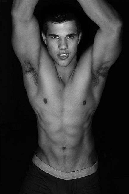 hottest pic of taylor lautner shirtless with his arms up showing off his 8 pack