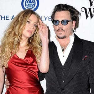 Amber Heard and Johnny Depp in photo at an awards show