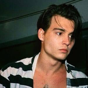 gorgeous pic of actor johnny depp in striped shirt showing off his hard chiseled jawline
