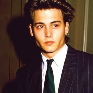 actor johnny depp in tie and suit when he was a young man
