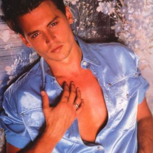 photo of Johnny Depp in shiny blue shirt and staring fiercely into the camera