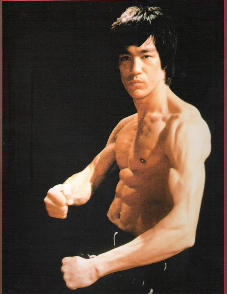 Bruce Lee flexing