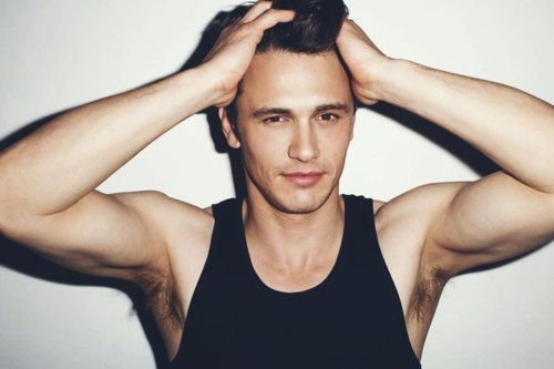 sexiest man alive james franco with his hands on his head in a tank top looking so hot
