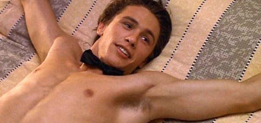 movie star james franco tied to a bed with a bow tie around his neck shirtless