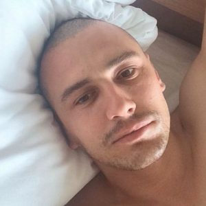 James Franco with a bald head taking a provocative selfie