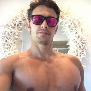 sexy james franco taking a pic with his shirt off and sunglasses on showing off his amazing chest