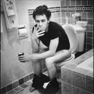 black and white pic of james franco sitting on a toilet with his pants down naked pic