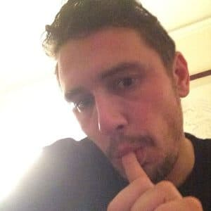 handsome actor james franco taking a selfie with his finger in his mouth