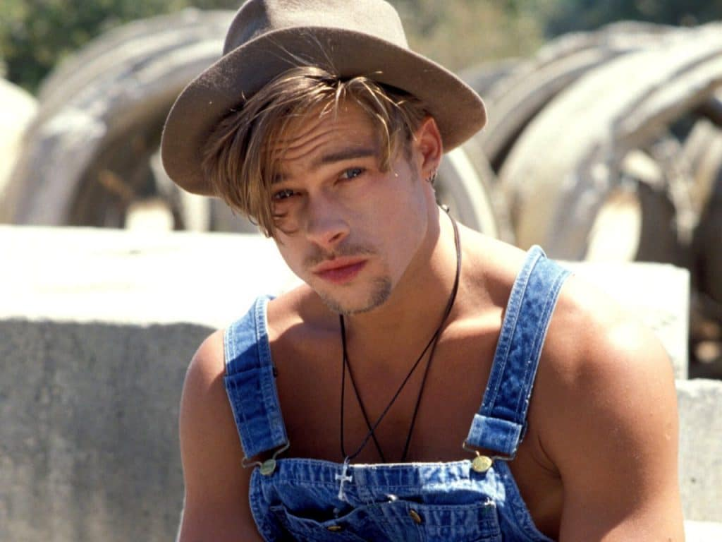 hot pic of brad pitt in overalls and a hat on