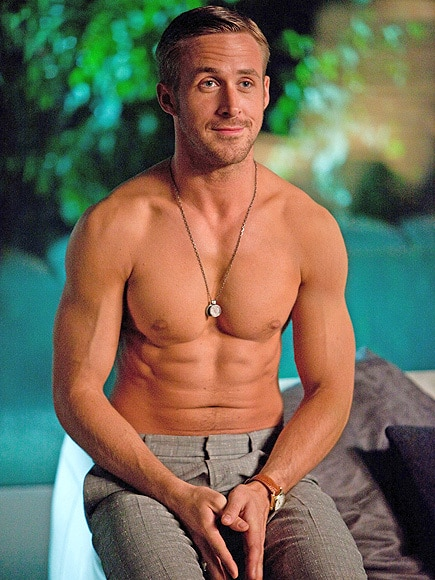 sexiest man alive ryan gosling with his shirt off showing off his amazing abs and smirking