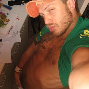 myspace pic of Tom Hardy showing off his abs and grabbing his cock