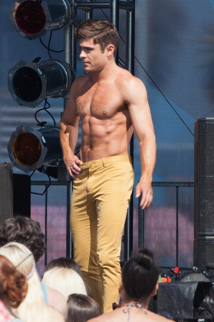 sexy zac efron showing off his tan abs