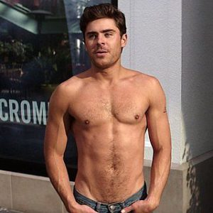zac with his shirt off and jeans