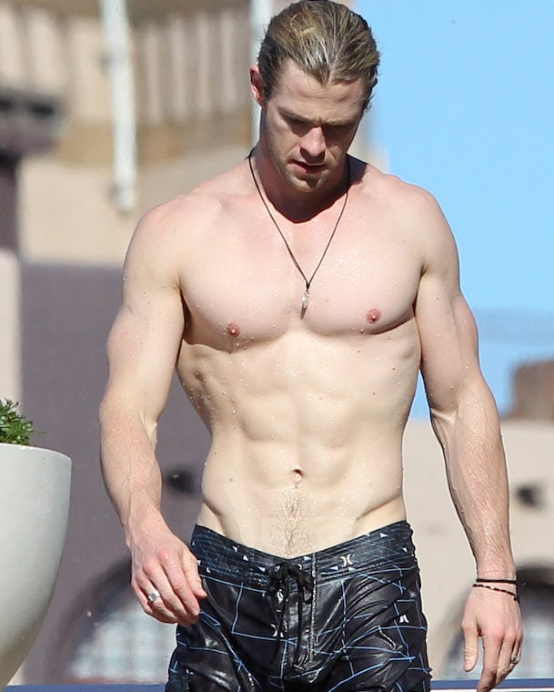 sexy Chris Hemsworth shows off his ripped body
