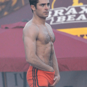 zac efron adjusts his package