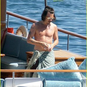 sexy johnny depp shirtless on a boat