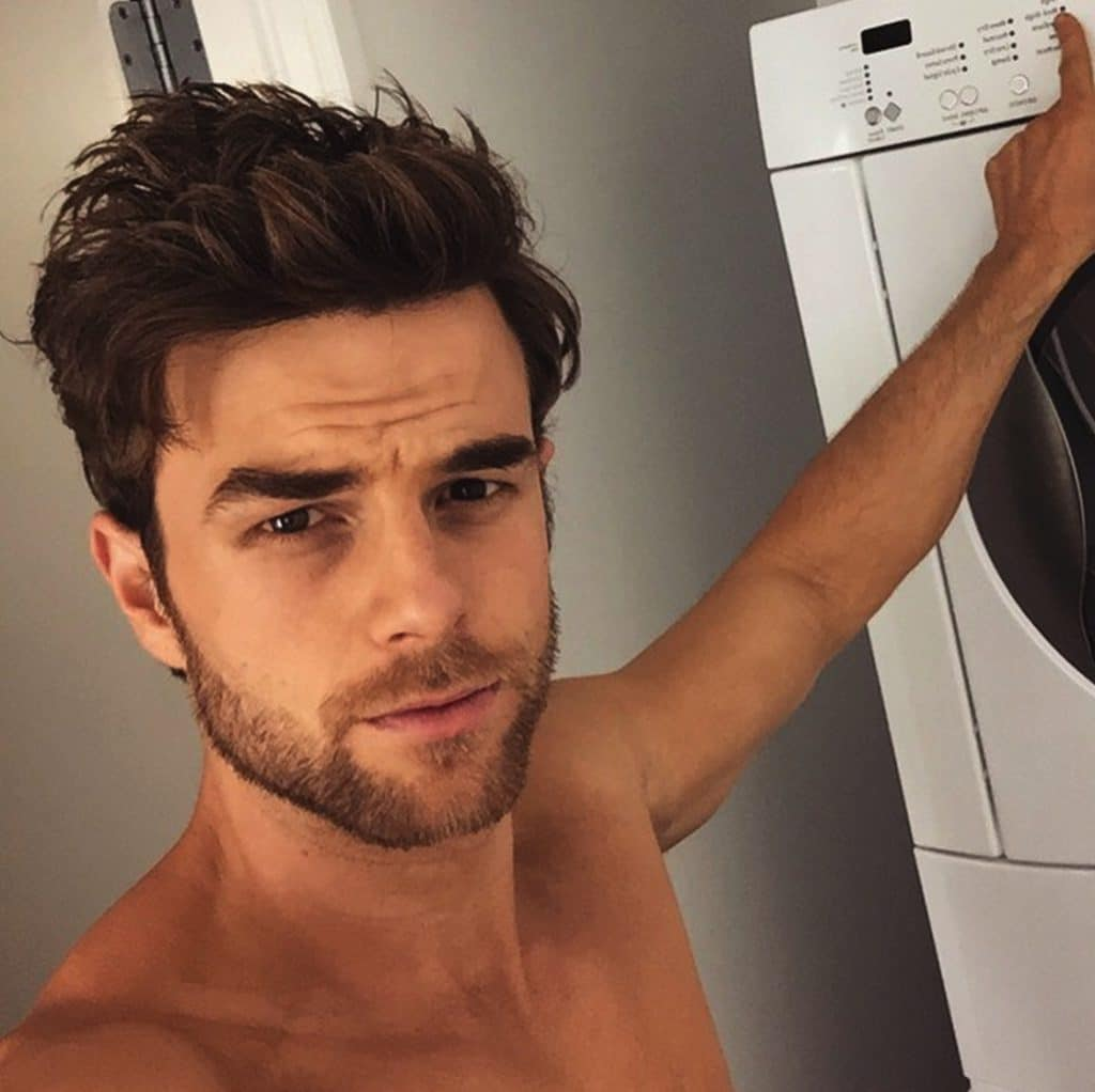 actor nathaniel buzolic looking sexy as hell shirtless by the laundry instagram pic