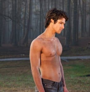 Teen Wolf Tyler Posey shirtless with his knees on the ground and showing off his built body
