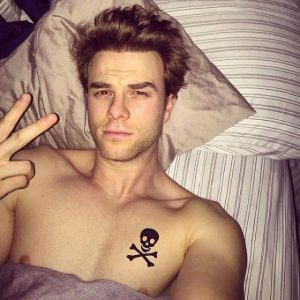 hot pic of nathaniel buzolic in bed with his shirt off