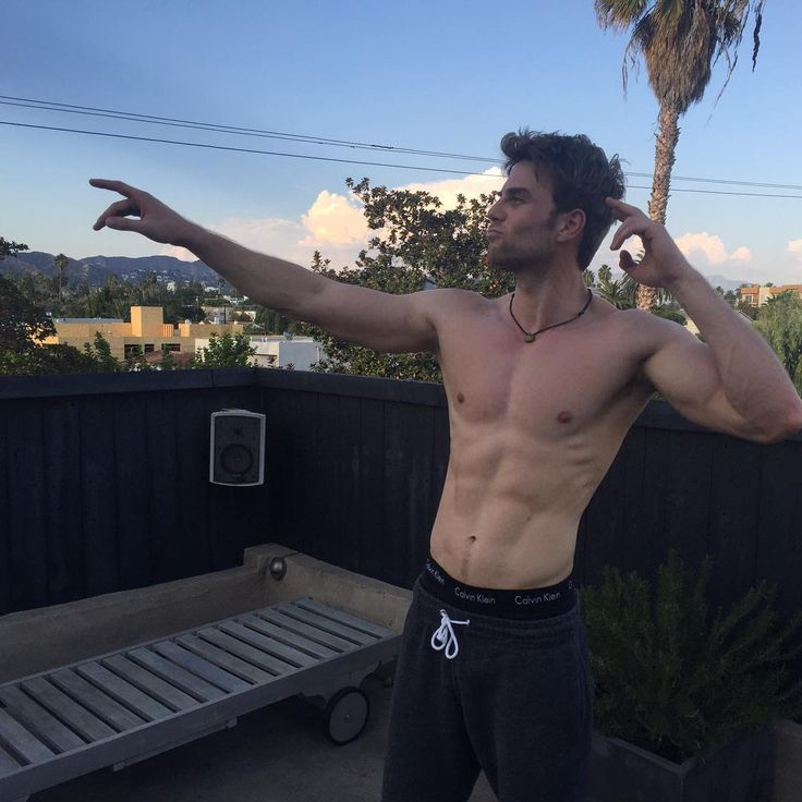 australian actor nathaniel buzolic pointing and shirtless showing abs