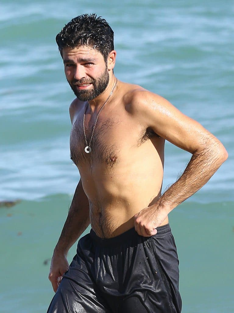 celebrity star adrian grenier nude chest and shirtless on the beach in miami with a hairy chest