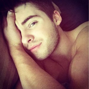 sexy selfie of cody christian shirtless grabbing his face