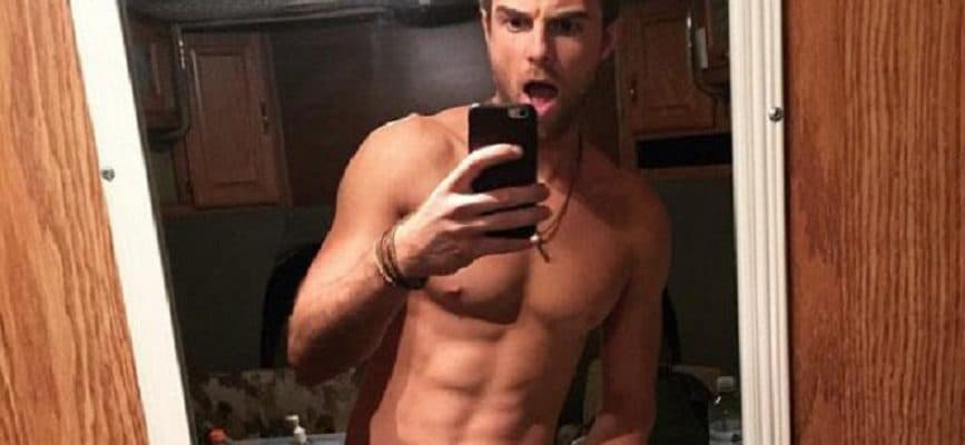sexy Australian actor Nathaniel Buzolic taking a selfie showing off his abs