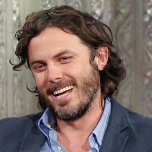 handsome casey affleck smiling big on the stephen colbert show