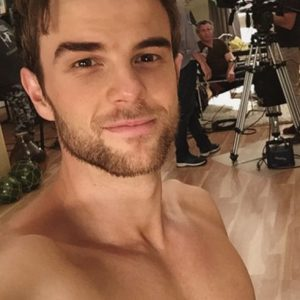 shirtless pic of nathaniel buzolic and giving a slight smile
