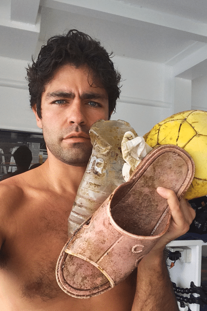 actor adrian grenier taking a selfie shirtless
