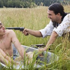 handsome and naked casey affleck in movie bathtub scene outstide