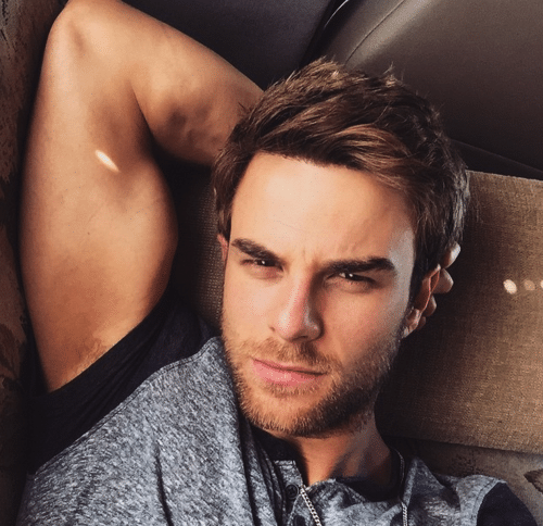 hot pic of nathaniel buzolic taking a selfie showing off his bicep and giving a fierce sexy look