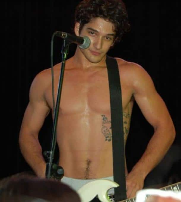 actor Tyler Posey shirtless on stage showing off his 6 pack