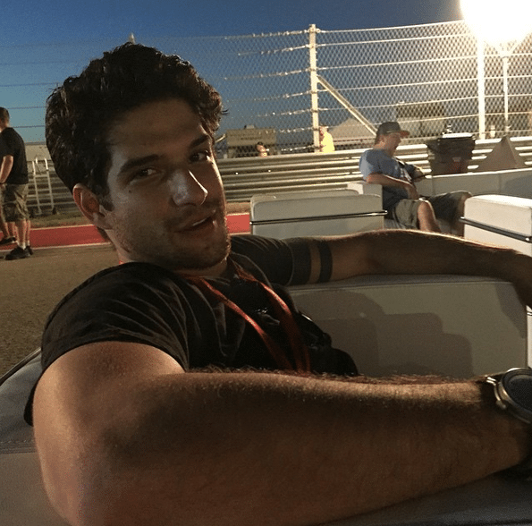 A picture of Tyler Garcia Posey sitting and looking gorgeous staring into the camera
