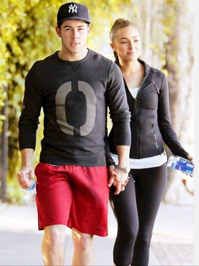 Jonas walking with Olivia and dick bulge in red shorts