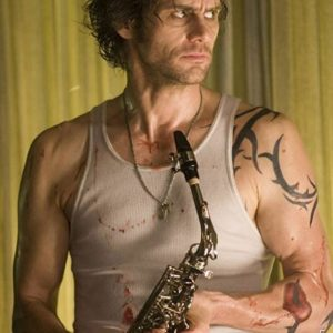Jim Carrey saxophone guy with tattoos