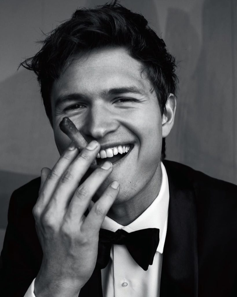 Ansel smiling with a cigar in a tuxedo