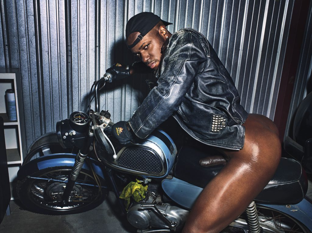 Milan Christopher naked booty on a motorcycle
