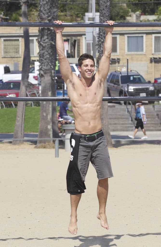 Dean Geyer ripped shirtless outdoors