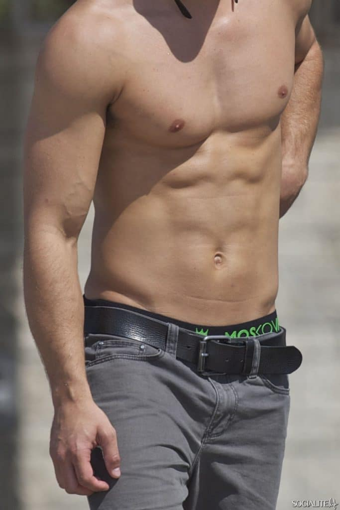 Dean Geyer shirtless photo of abs and arms