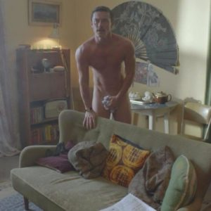 Luke Evans covering his cock