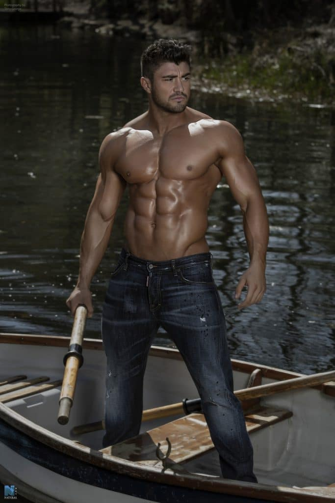 Rogan O'Connor shirtless in a canoe