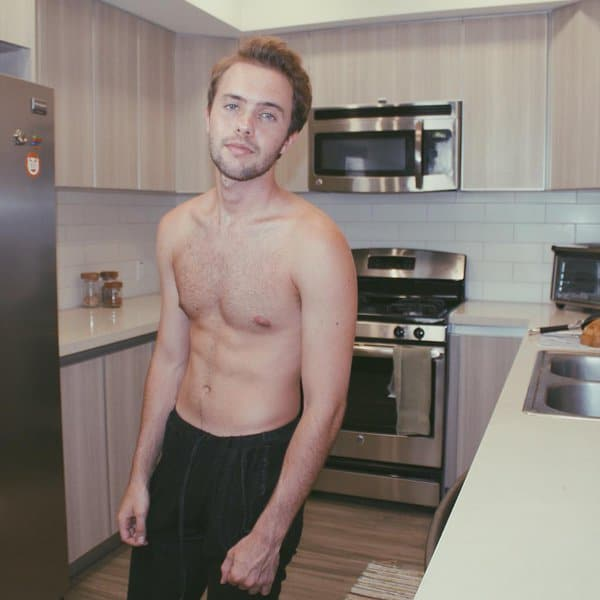 Ryland Adams in the kitchen with no shirt
