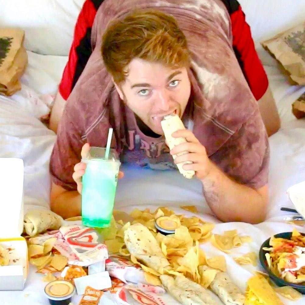 Shane Dawson eating a burrito