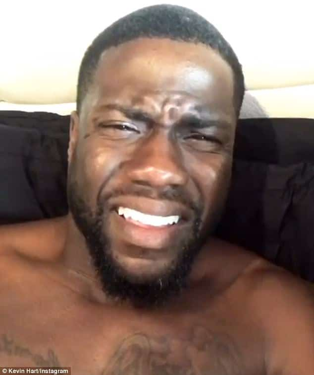 Kevin Hart taking a shirtless selfie in bed