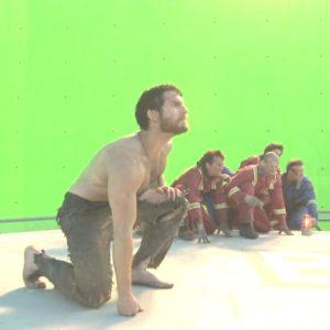 Henry Cavill kneeling