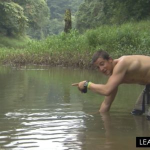 Bear Grylls demonstrating something